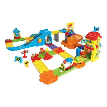 "Best for ages: 1 to 5 years Through pretend play, the Go! Go! Smart Wheels® Train Station Playset by VTech® will turn your child into a little conductor! The motorized train on this train set choo-choos its way along the tracks and plays imaginative phrases, music or phrases at each of this toy train set's ten SmartPoint™ locations. Learn time concepts, colors and phrases in English and foreign languages at the electronic train station, or use the hand-crank to drive the train up the hill and watch it chug down the spiral ramp. The motorized SmartPoint™ Train engages your child with 3 sing-along songs and teaches the letter ""T"". The learning doesn't stop there! This toy train set's 32 interchangeable track pieces reconfigure for multiple configurations and 15 feet of play! They also connect to other Go! Go! Smart Wheels® playsets (sold separately) to encourage your child's creativity. It's playtime with miles of learning! Product Number: 80-146700 Battery: 3AA Batteries Required"